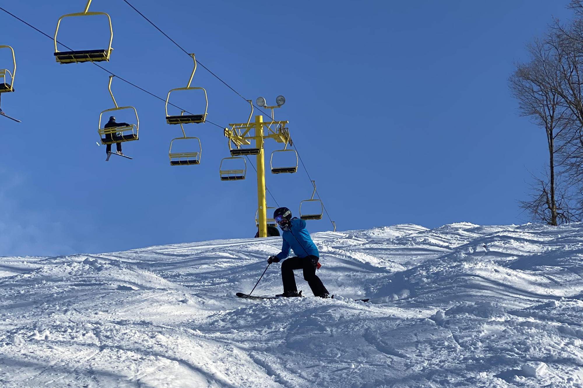skiing moguls yellow chair