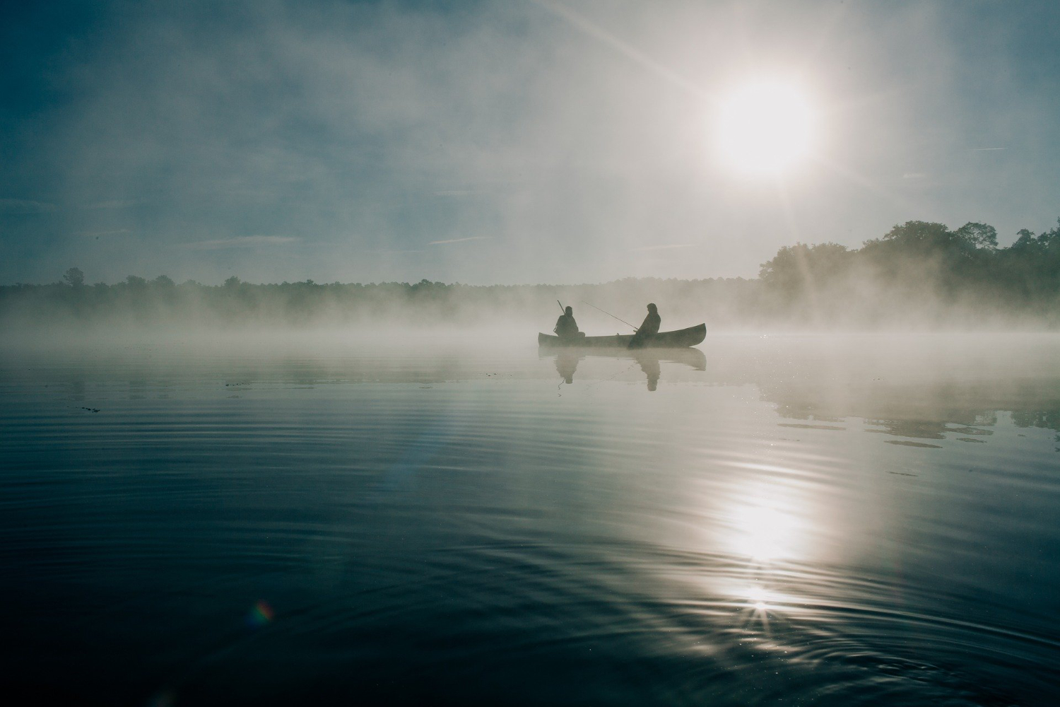 fishing in the fog on a kayak