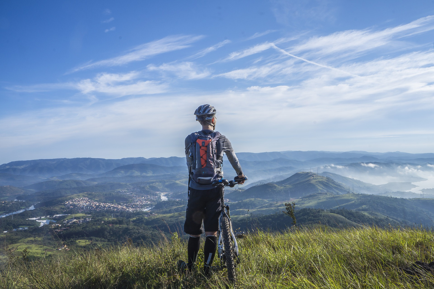 mountain biker looking out scenic view
