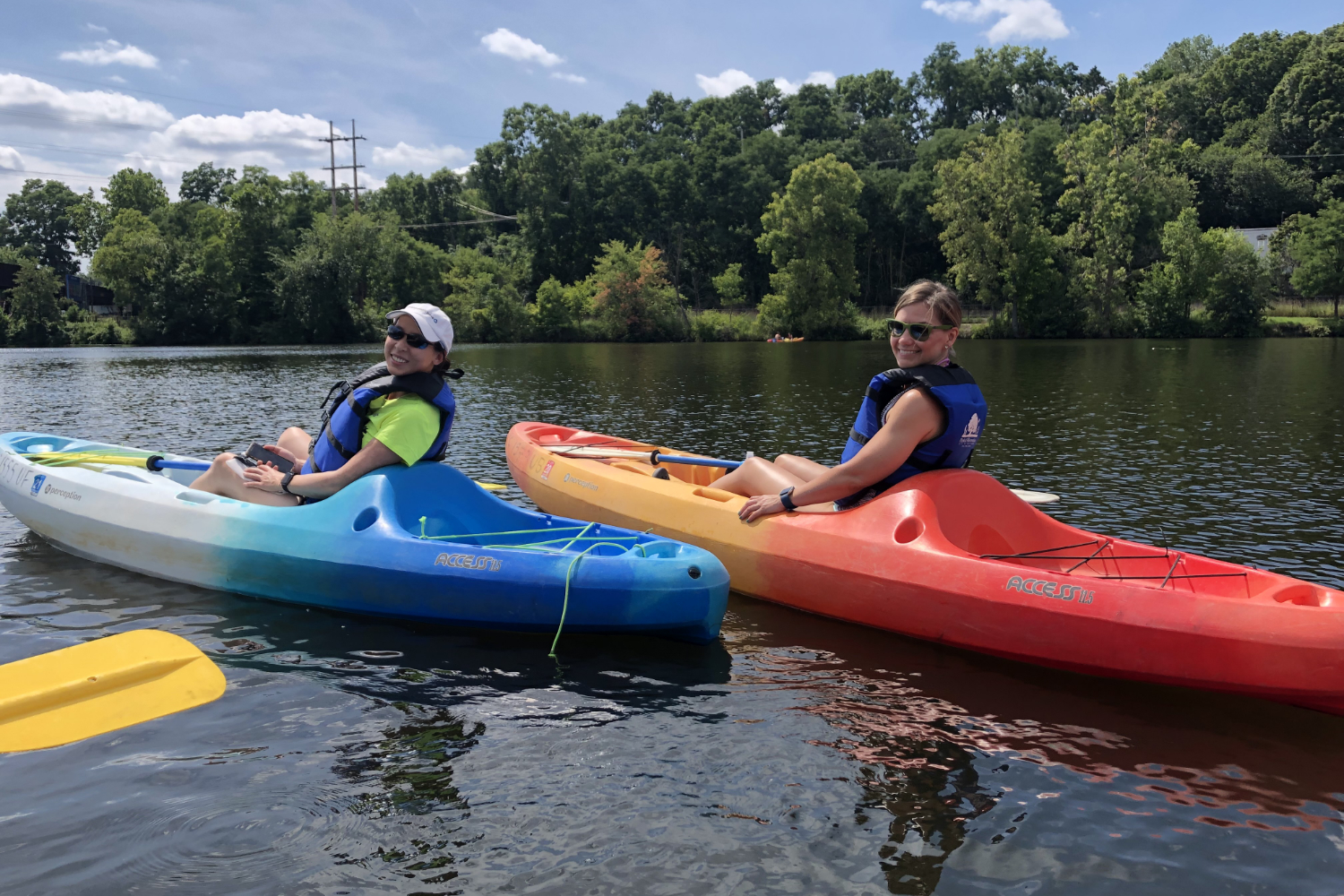 2 kayakers on a river