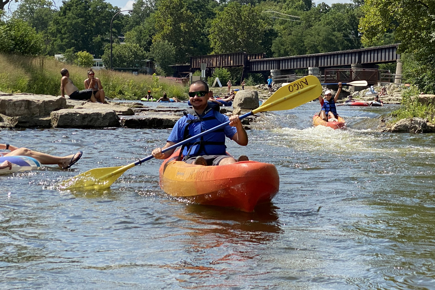 kayaking down the river in summer