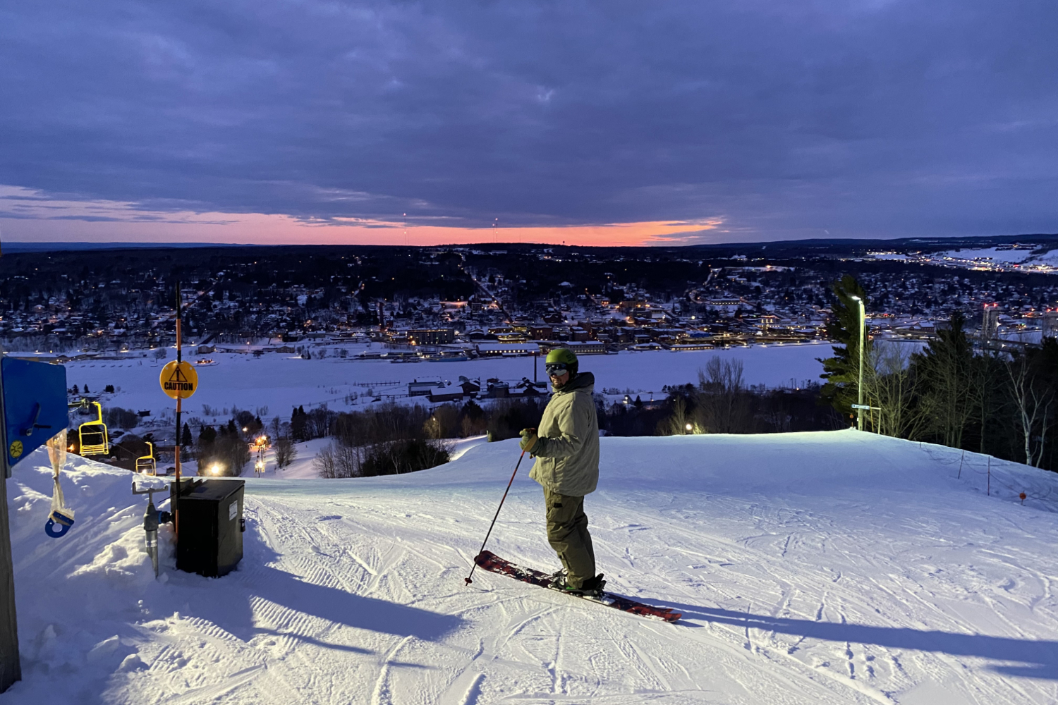 skier at sunset on top of mountain