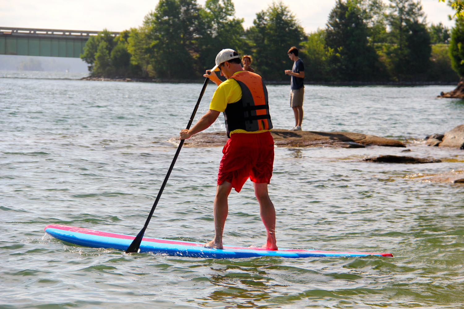 stand up paddle boarder on lake
