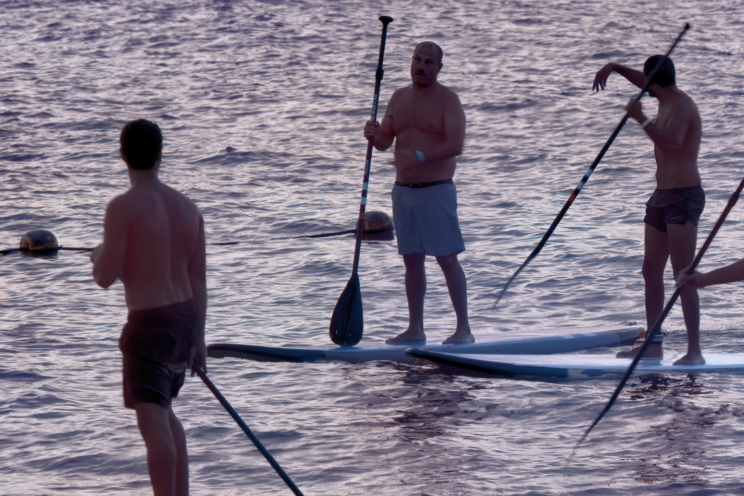 group of big guys on paddle boards
