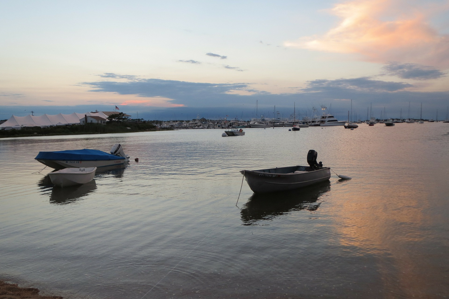 several dinghies anchored at sunset