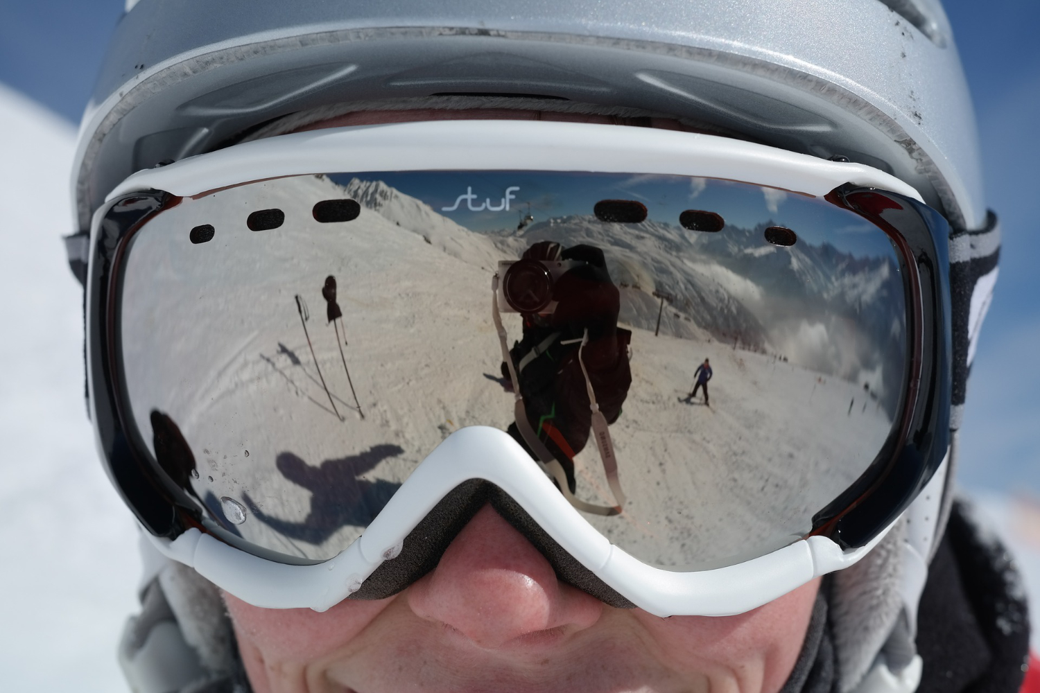 silver lens ski goggles reflection