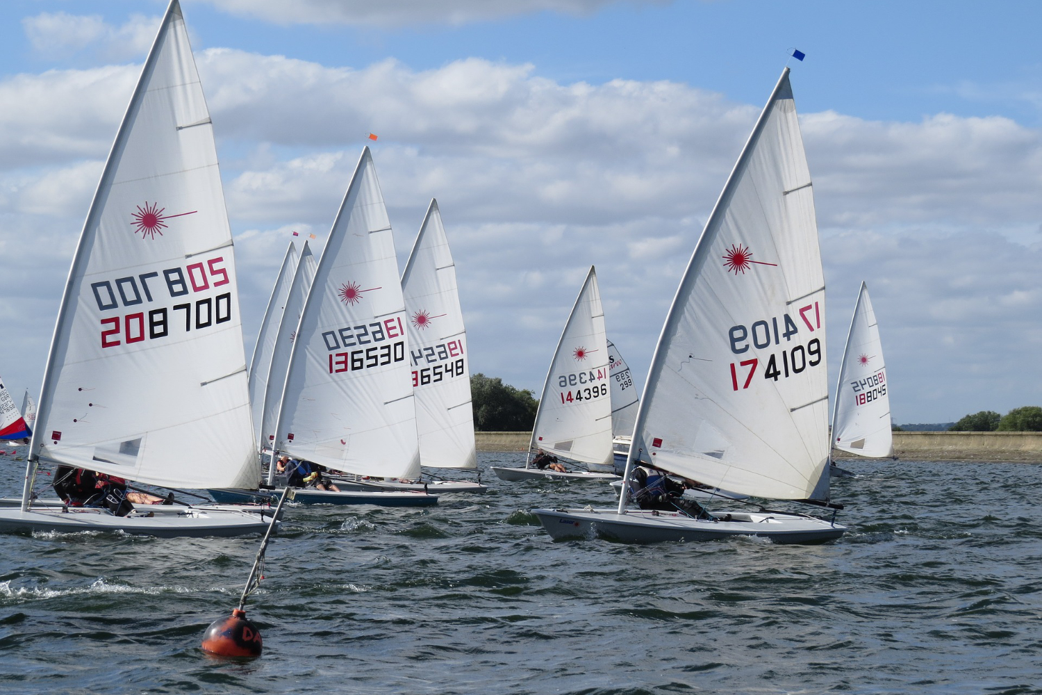 laser sailors racing on cold day