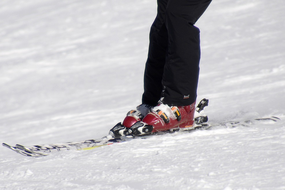red ski boots on cold snow