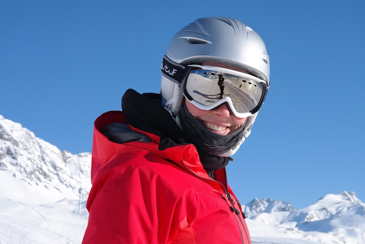 skier in the mountains with neck warmer
