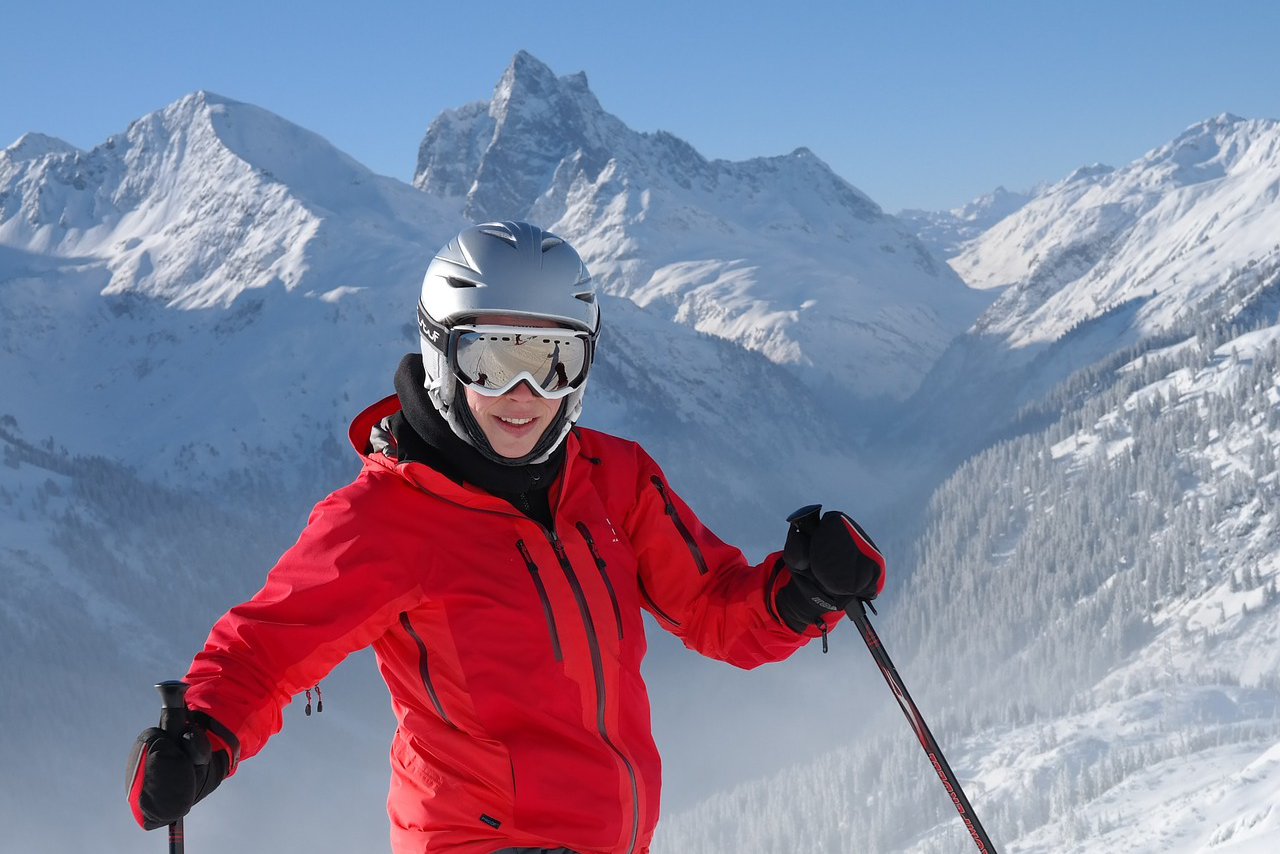 skier wearing goggles big mountains