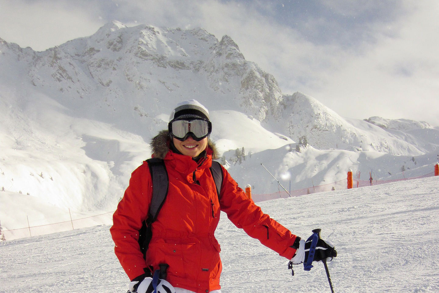 skier wearing goggles mountain background
