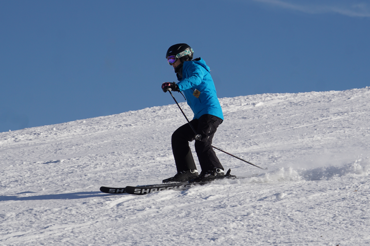 skier with new skis skiing