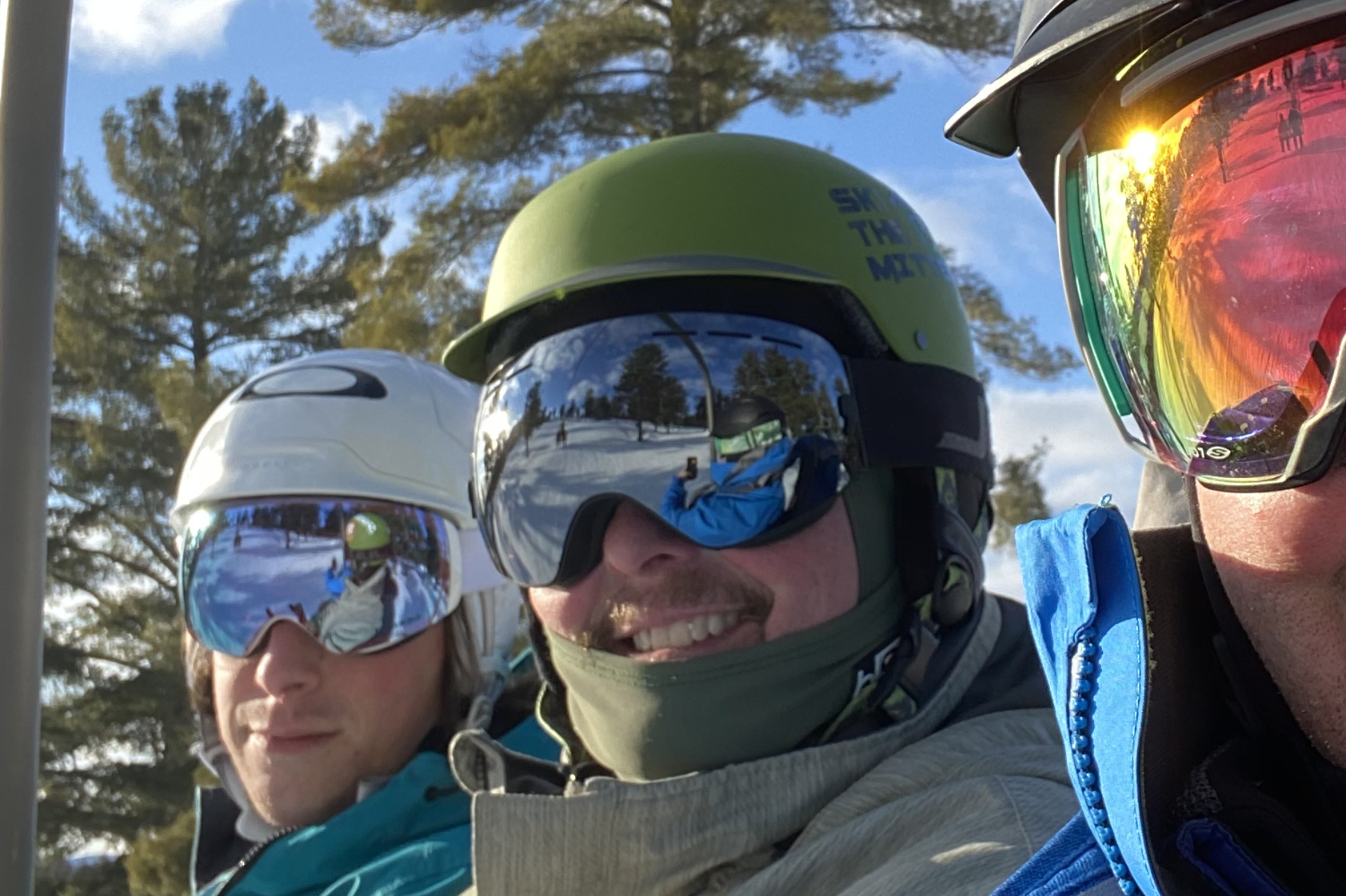 skiers wearing ski goggles on chairlift