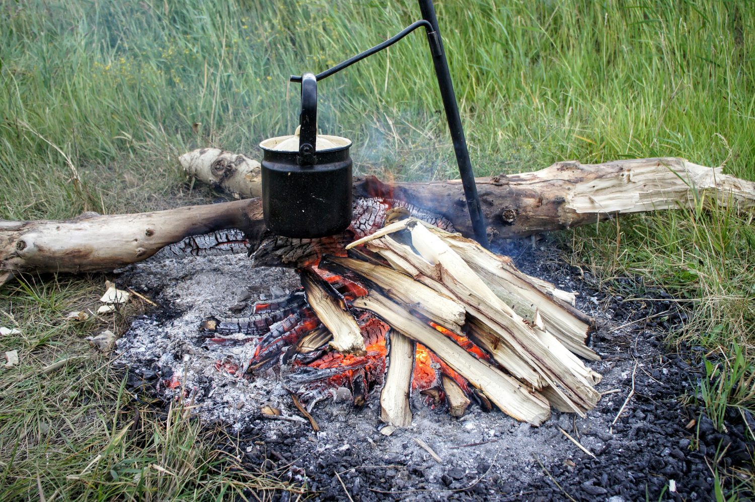 cooking pot hanging over open fire