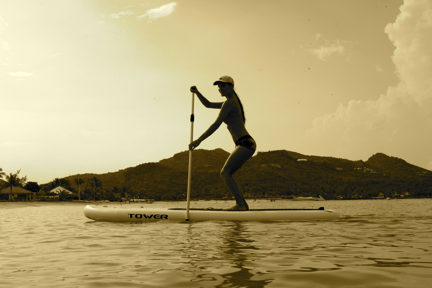 paddle boarding on inflatable board at sunset