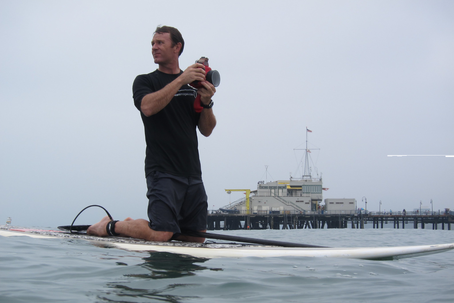 taking picture from stand up paddleboard