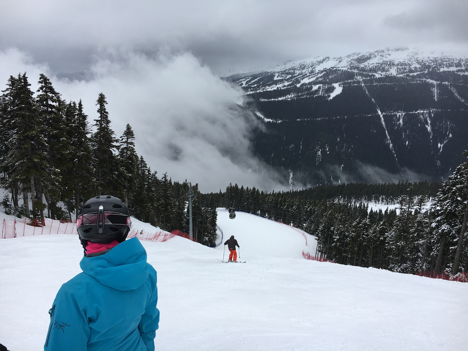 ski lesson group above clouds